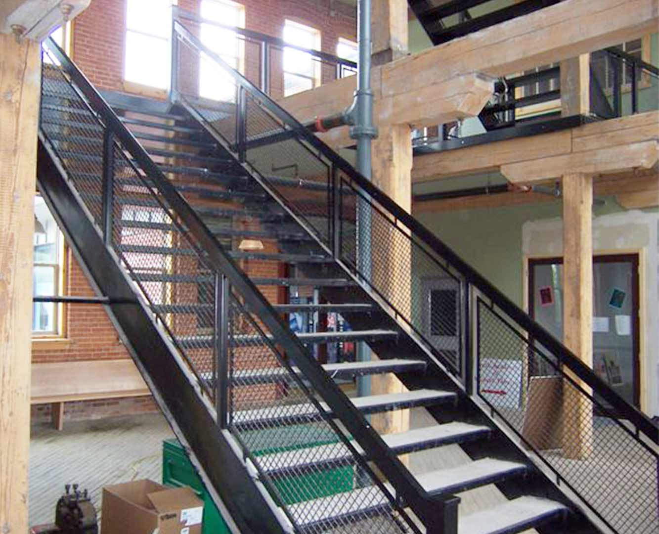 Industrial Metal Staircase with Mesh Panels